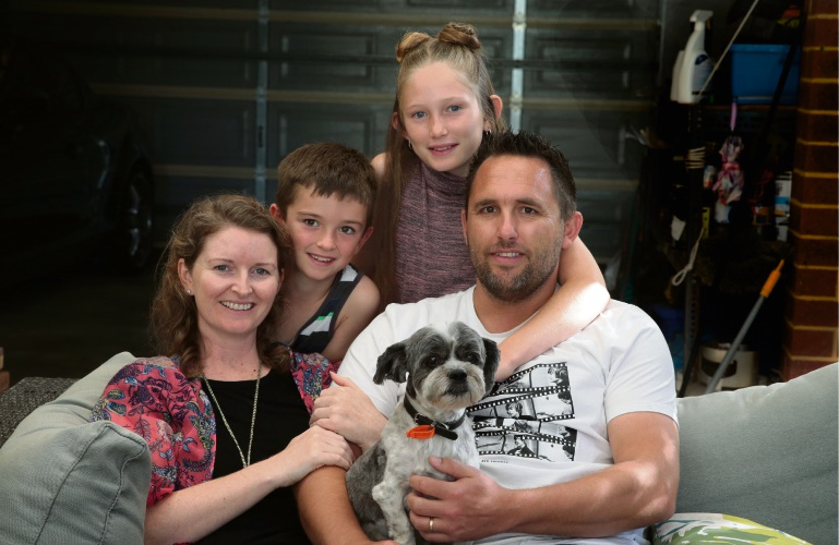 Fleur and Darren Kay (Quinns Rocks) with their children Jack (7) and Madison (11) and dog Ewood. Picture: Martin Kennealey d482261