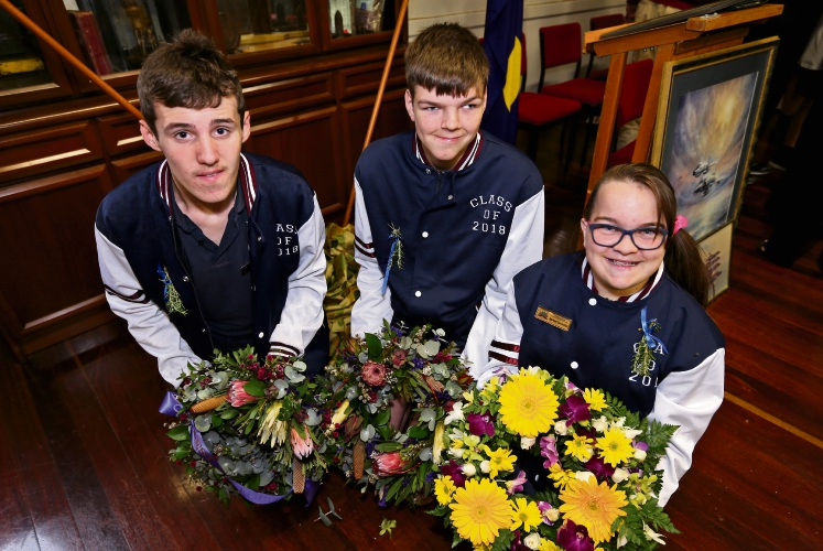 Students laying wreaths: Jack Hall, Connor Chapman and Chloe Henderer. Picture: David Baylis d481564