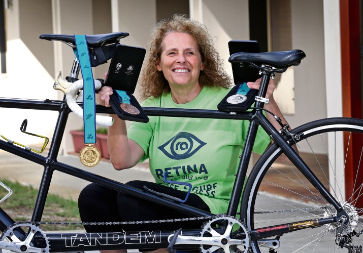 Lyn Lepore of Ballajura with some of her medals and her tandem bike. Picture: David Baylis www.communitypix.com.au d482329