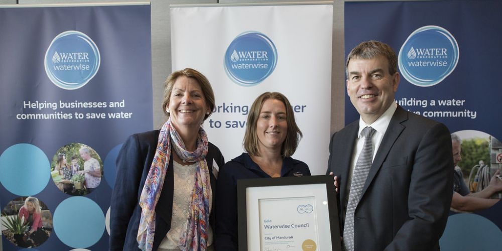 Deputy Mayor Caroline Knight, Natalie Lees and Water Minister Dave Kelly celebrate recognition of the City's Gold Waterwise Council status.