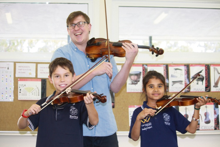 Year 4 students Weast Stanaway and Semira Jacobs-Bolton under tuition from WASO teacher Griffin Wright.