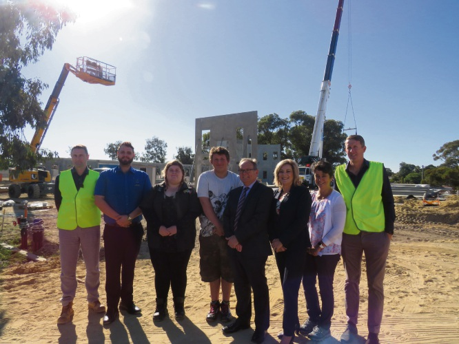 Alita Constructions owner Ali Kleyn, Peel Youth Services care coordinator Joseph Gauci, Caitlin and Brock Elphick, Murray-Wellington MLA Robyn Clarke, Eleanor Britton and project manager Ian French at the site of the new Peel Health hub.