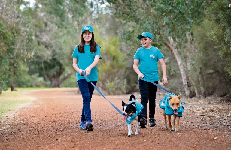 L-R: Alyssah Tompsett (14) with three-year-old rescue dog Astro and her brother Ben with rescue dog Poppy. Photo: David Baylis
