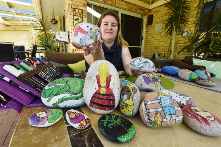 Emma Cottrell with some of her decorated rocks. Picture: Jon Hewson.