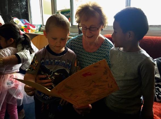 Aussie Kidz pupils presenting their crafty cards to Faulkner Park Retirement village residents.