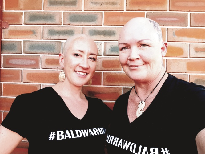 Kam Waihi (left) after shaving her head to support friend Kathi Tait, who has a rare hair loss condition.