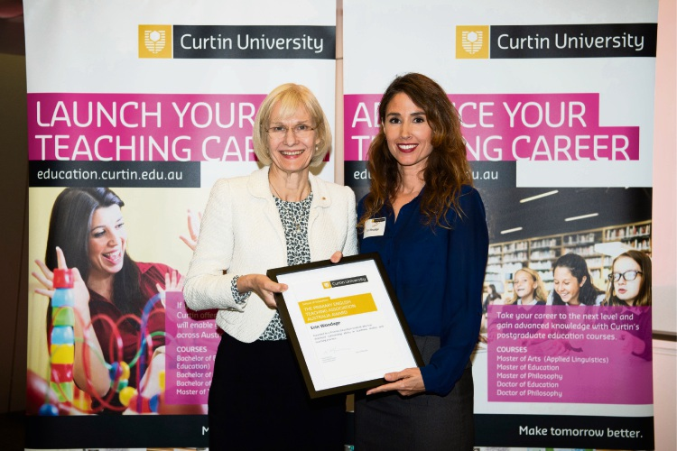 Erin Woodage (right) with Curtin University vice-chancellor Professor Deborah Terry.