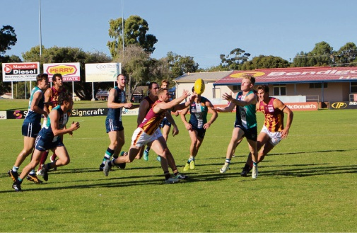 Peel and Subiaco gather to wrestle for the ball.
