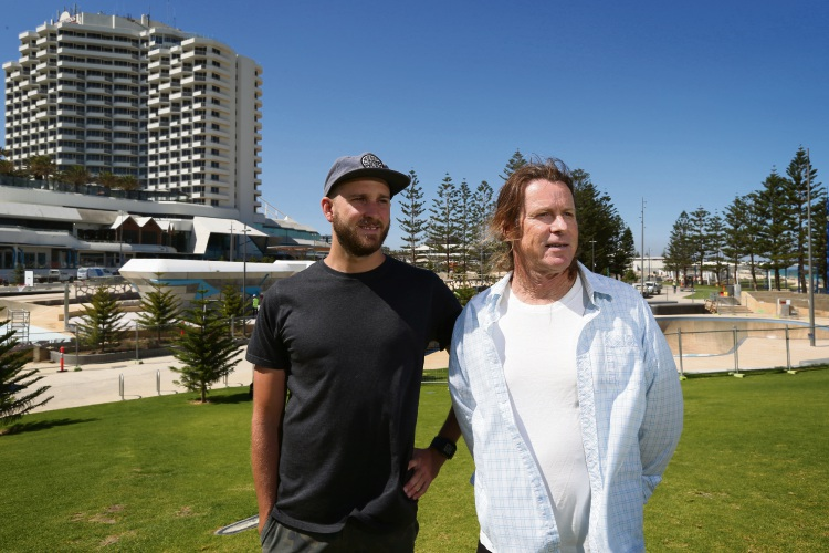 Scarborough Beach Association chairman Wayne Bowen, pictured with Rip Curl Scarborough manager Mike Counsel, is calling on the State Government to release outcome a shark monitoring system trial.
