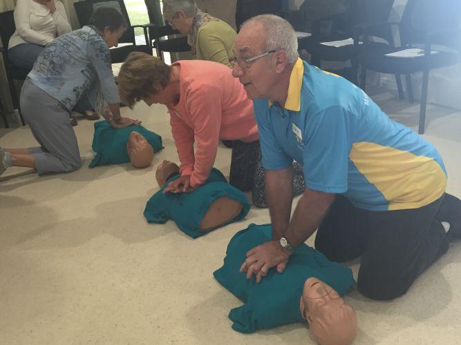 Volunteers take part in CPR exercises.
