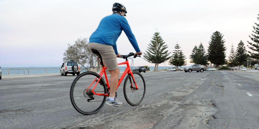 Potholes, cracks and gouges cover 650sq m of the carpark at Cottesloe Beach. Picture Jon Bassett