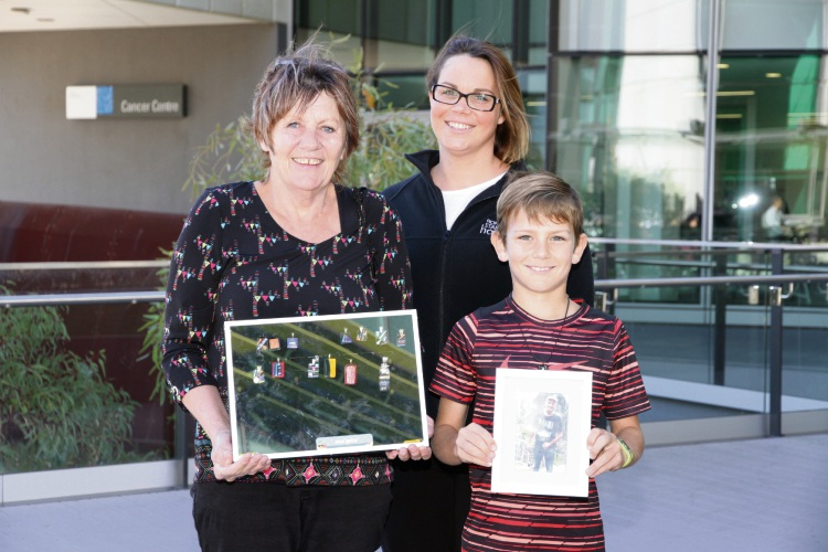 Eight-year-old Max Birch with his grandma Kaye Donnelly and Fiona Stanley Hospital nurse unit manager Nyrene Jackson.