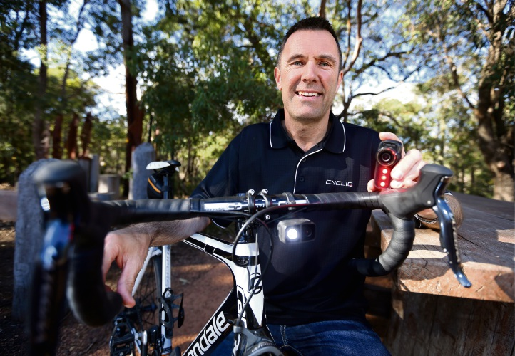 Kingsley Fiegert of Bickley with his Cycliq Fly 12 CE front light (on bike) and Fly 6 CE rear light (in hand), from the Cycliq connected editions range. The WA business has won gold at the Australian Good Design Awards in Sydney for their dash cam for cyclists. Picture: David Baylis d483149