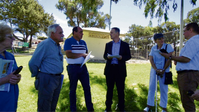 Hillarys MLA Peter Katsambanis discusses the issue with lead petitioner Paul Roberts and other concerned residents.