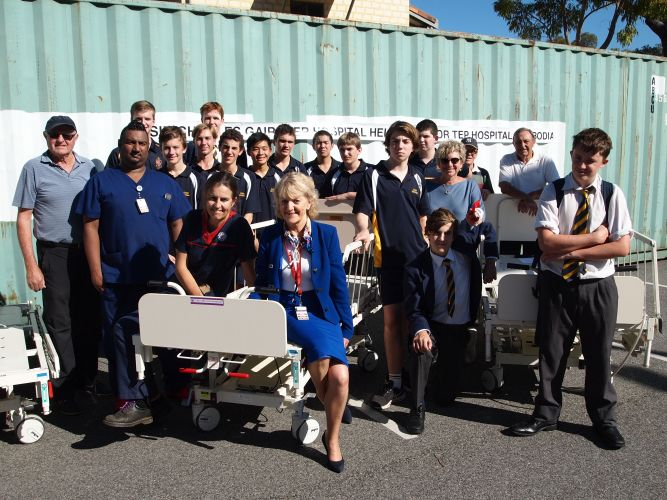 Senior radiologist Dr Anita Bourke, front, with volunteers and Christ Church Grammar School students. The team packed a sea container full of donations for the Nokor Tep Foundation in Cambodia. Photo: Supplied.