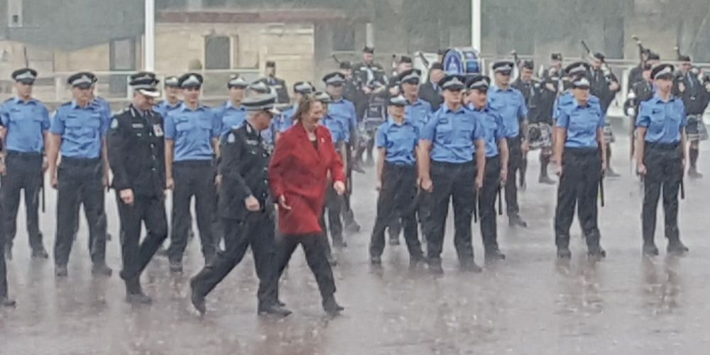 Police Minister Michelle Roberts and WA Police's newest graduates in today's downpour.