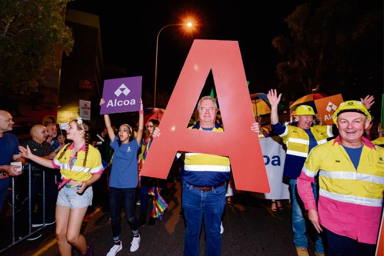 Mark Hodgson leads the march for Alcoa in the 2017 WA Pride Parade.