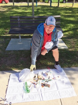 Burns Beach MLA Mark Folkard with litter collected in the Joondalup 'plogging' session.