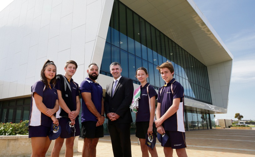 Head of Sport Mat Davis and Principal Rob Marshall with talented swimmers Tatiana Valentim, Riley Loller, Charlotte Ward and Jake Harvey.  Picture: Martin Kennealey d482414