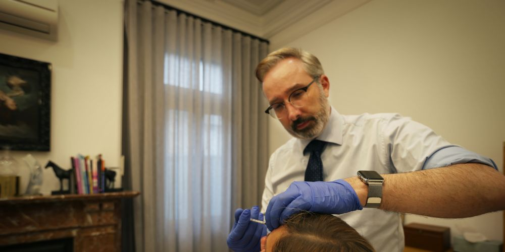 Dr Andrew Clark (Cosmetic Physician) injecting wrinkle relaxer