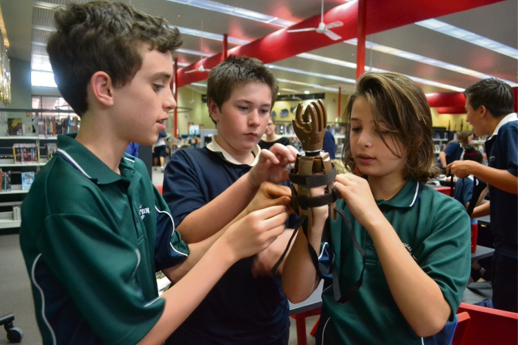 James Wood, Jon-Pierre Linderman Sinclair and Ennio D'Agostino from Shenton College taking part in the Helping Hands project. Picture: Jessica Warriner