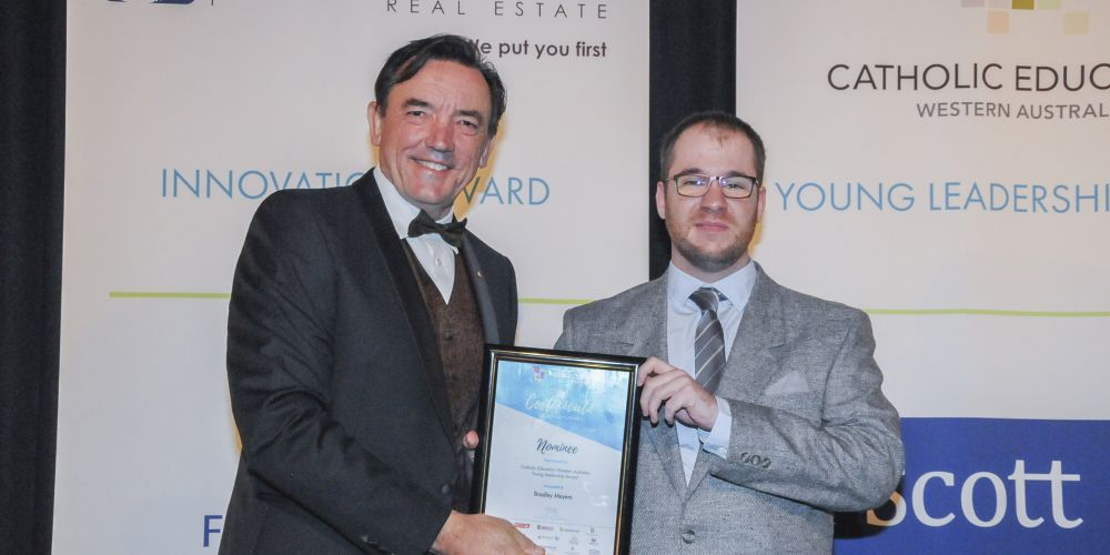 Youth Minister Peter Tinley presenting Bradley Meyers with his certificate.