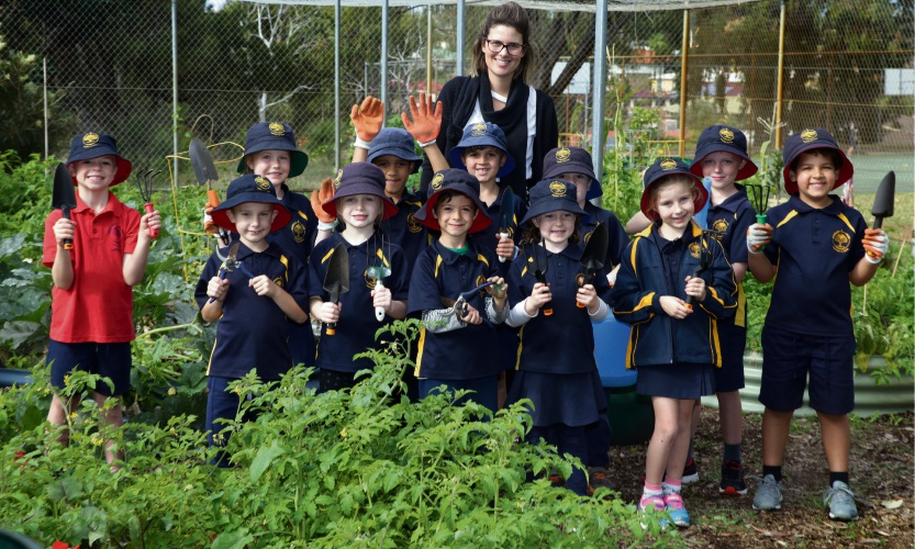 Teacher Codi Beatty and her year 1/2 class. Picture: Martin Kennealey d482971