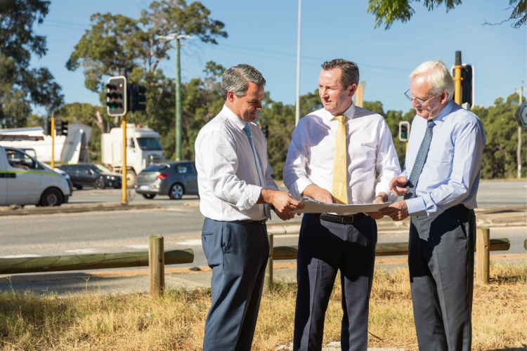 Forrestfield MLA Stephen Price, Premier Mark McGowan and Kalamunda MLA Matthew Hughes inspect plans for a new interchange on Roe Highway in Maida Vale.