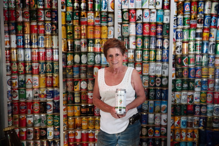 Janet Prudhan (Gidgegannup) holds the commemorative beer can in The Museum of Pubs. Picture: Martin Kennealey d482361