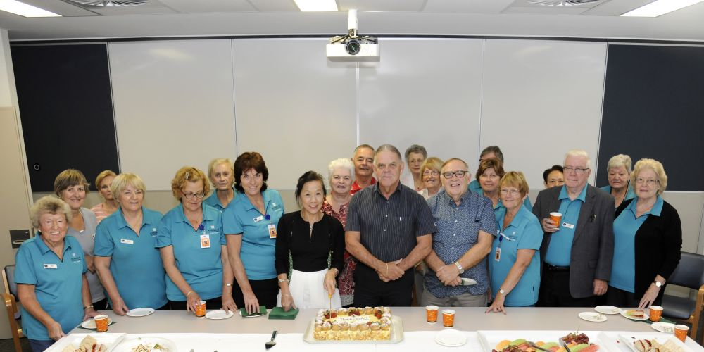 Joondalup Health Campus deputy chief executive Amanda Ling with volunteer coordinator Peter Johnson with some of the volunteers.