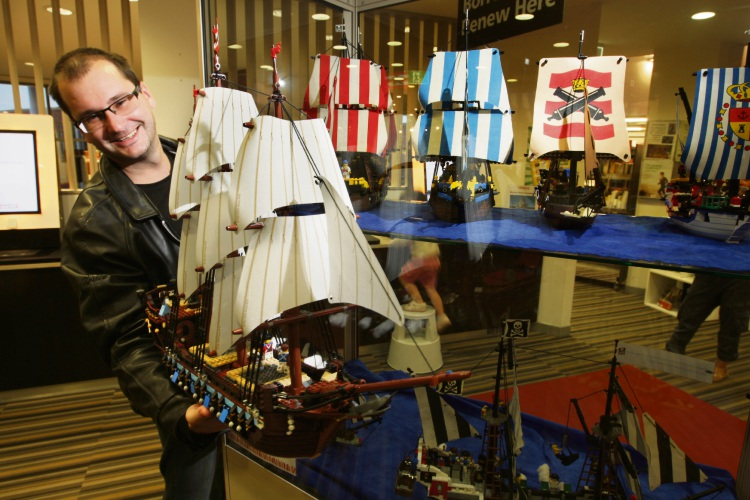 Serg holding a model of his Imperial Flagship with his other Lego. Photo: Bruce Hunt