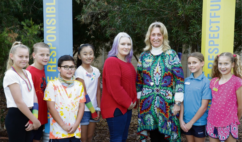 Stephanie Buitenhuis (programs coordinator The Smith Family) with School chaplain Shirley Pyrc with students Anna Lewis Griffiths, Preston Stewart, Farham Fathalian, Jasmina Borkovic, Elyse Hutton and Esmae Milton. Photo: Martin Kennealey