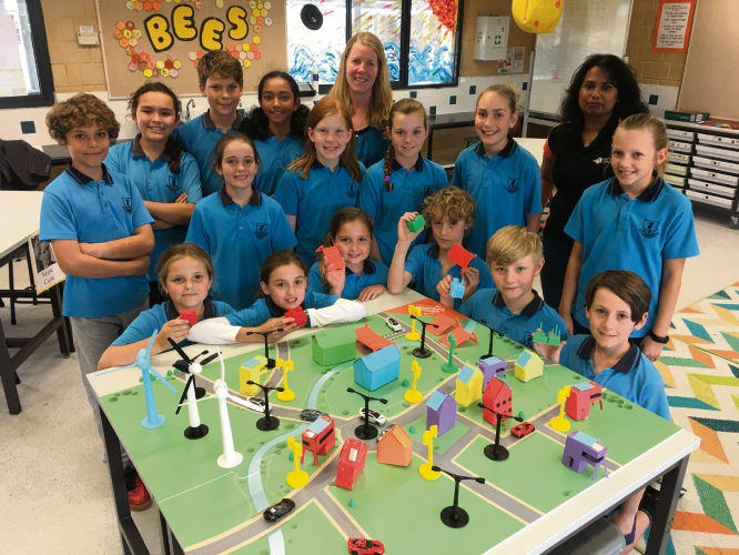Deanmore Primary School teacher Melinda Carr and Western Power engineer Dona Wijayasinghe with students who took part in the Circuit Breakers program last year.