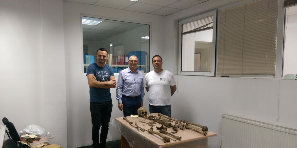 Murdoch University forensic scientist James Speers, centre, with Valon Hyseni and Ditir Haliti from the National Institute of Forensic Medicine examine human remains in Kosovo.