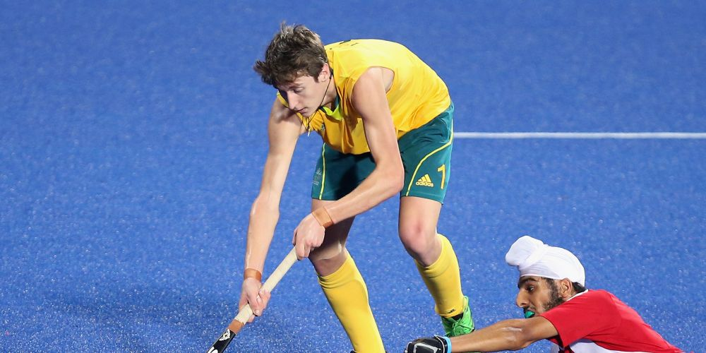Matthew Bird of Australia competes the ball against Amrit Sidhu of Canada in Hockey's Men's Gold Medal Match on day 11 of the Nanjing 2014 Summer Youth Olympic Games in China.  Picture: Feng Li/Getty Images.