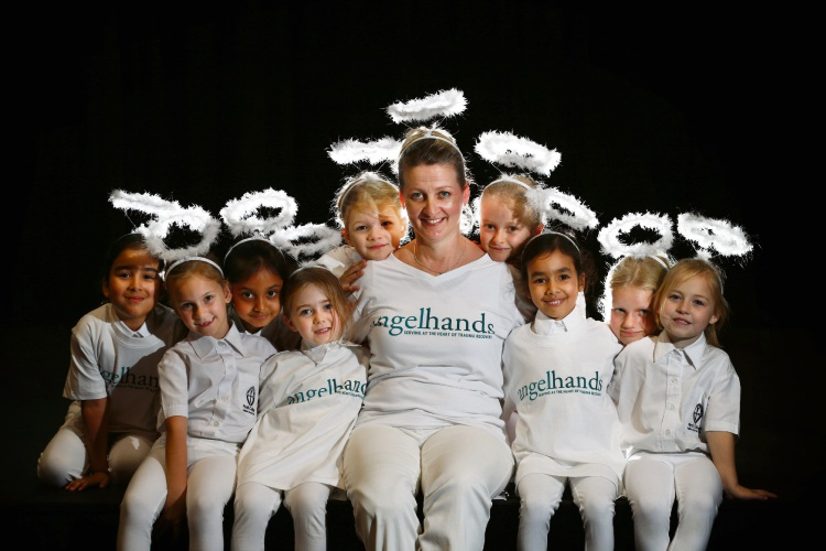 Ann O''Neill from Anglehands with some year ones from Perth College wearing angel gear. Picture: Andrew Ritchie