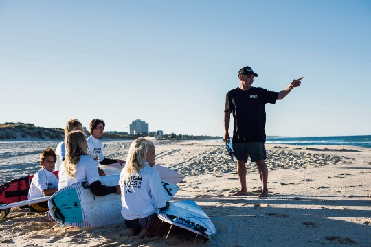 Damon Hayes with surf academy students.