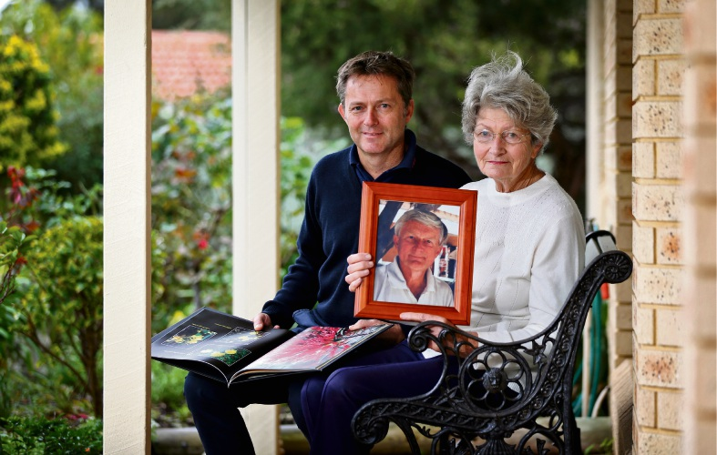 Martin Oldfield (son of Barrie and Sallie) and Sallie Oldfield, seen here with a framed picture of Barrie and his published book of the wildflowers located in Willoughby Park. Photo: David Baylis