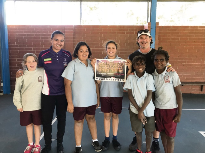 Swan View PS student Roze Munro, Fremantle player Emily McGuire, Betty Moore, Keturah Clinch, V Swans community manager Shane Beros, Uriah Lane and Nazareth Jones.