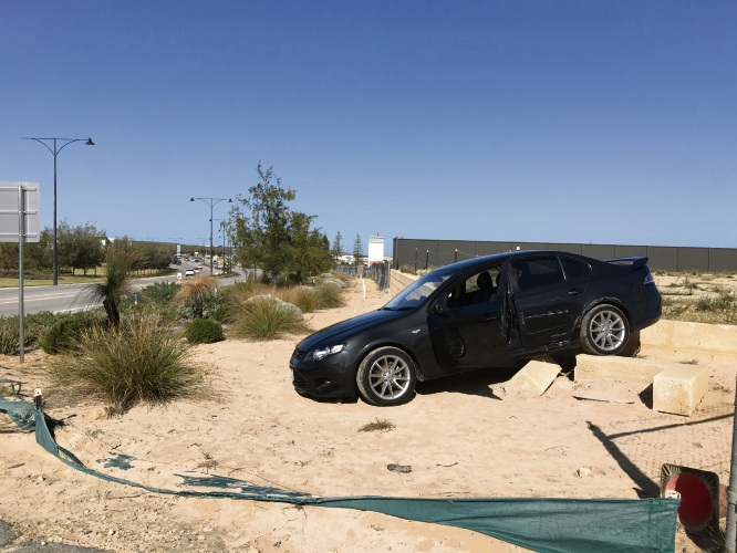 Police are hoping that forensic tests will help to identify the driver of this stolen black Ford XR6 left abandoned in Jindalee. Pictures: Martin Kennealey
