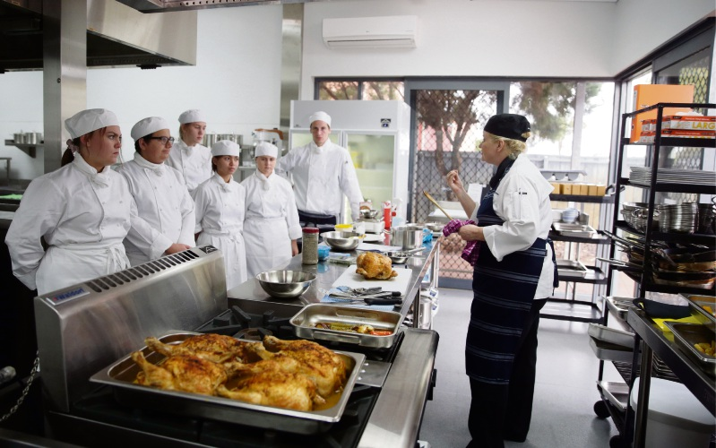 North Metropolitan TAFE chef Claire Rowley with Year 11 students Kayleigh Coghlan, Austin Bourke, Amber Schneider, Mai Anh Tran, Casey Cole and Jaice McGibbon.  Picture: Martin Kennealey d483502