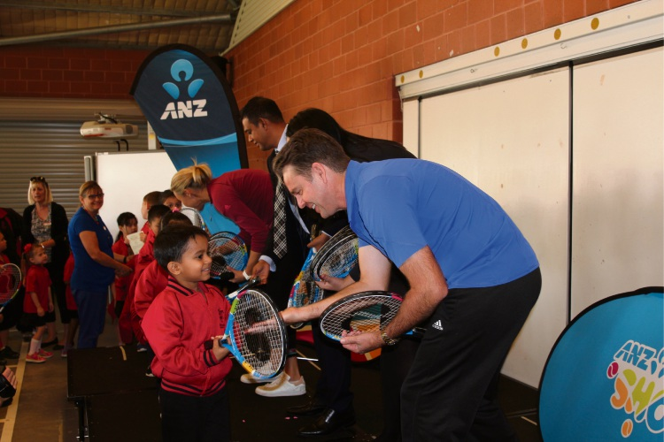 Todd Woodbridge (front) and Alicia Molik gave out tennis racquets to students at Gibbs Street Primary School recently.