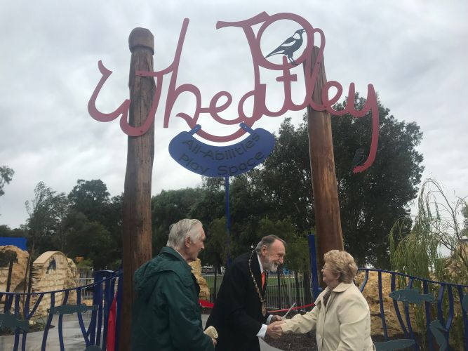 Vern Wheatley, Nedlands Mayor Max Hipkins and Jo Wheatley cutting the ribbon to the Jo Wheatley Play Space.
