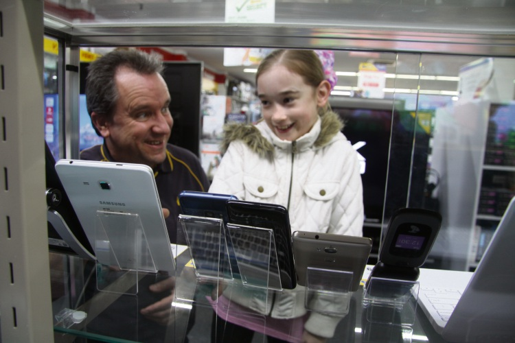 Betta Electrical Store Manager Paul Newcombe looks at devices with Chloe Colquhoun.