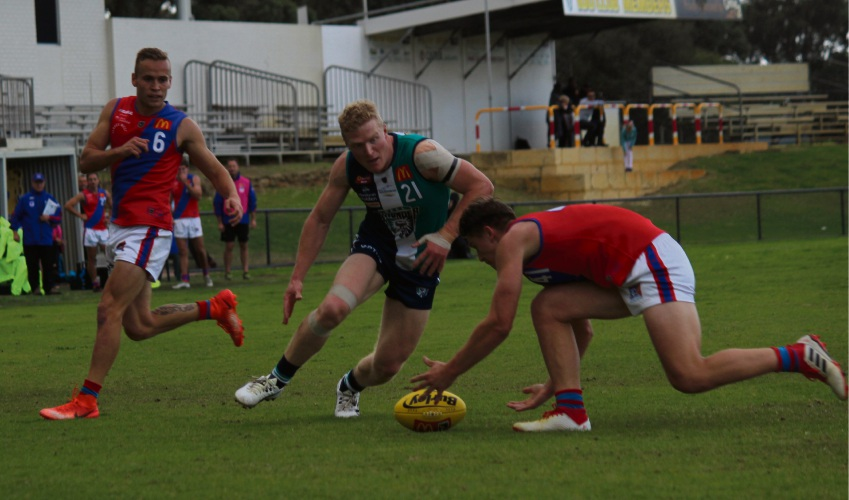 Peel Thunder player Blair Bell moves in on the ball.