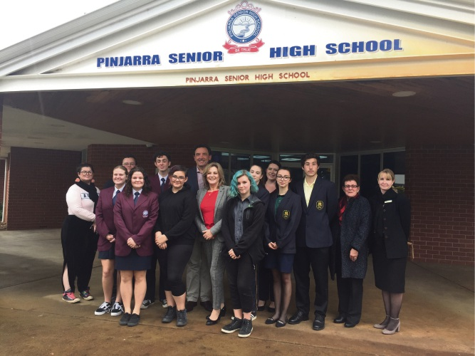 Peter Tinley (third left, back row) and Robin Clarke (in red) with students and other interested parties outside Pinjarra Senior High School.