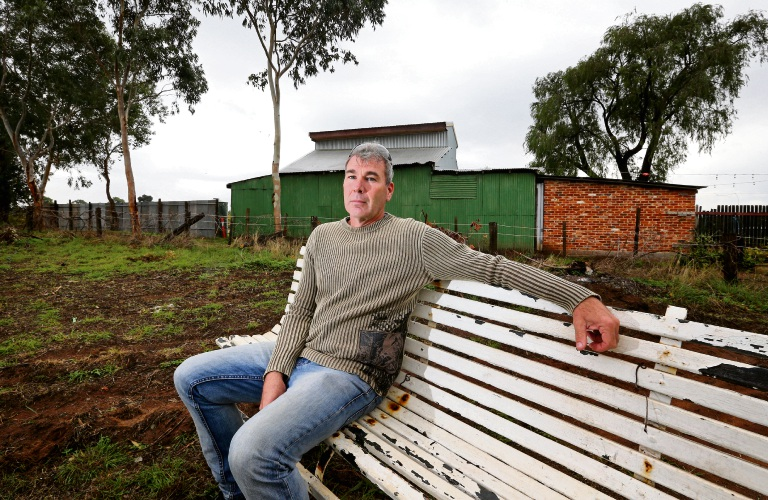 Sitting on the fence: Mathew Stevens, of Henley Brook, is unhappy that the council is allowing a development to be built right on the shared fenceline without a setback. Picture: David Baylis www.communitypix.com.au   d483697