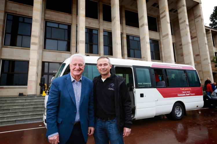 North Perth Community Bank Chairman Nick Catania and Deputy Premier Roger Cook with the bus that will be auctioned.
