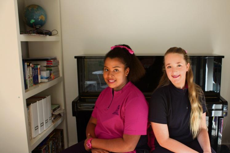 Australian Girls Choir members Angelika Durczak-Anyikwa (11) and Georgia Stewart (12).
