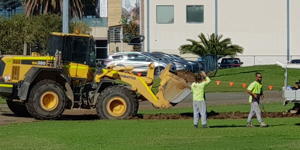 A front end loader gets to work at Midland Oval. Picture: David Baylis